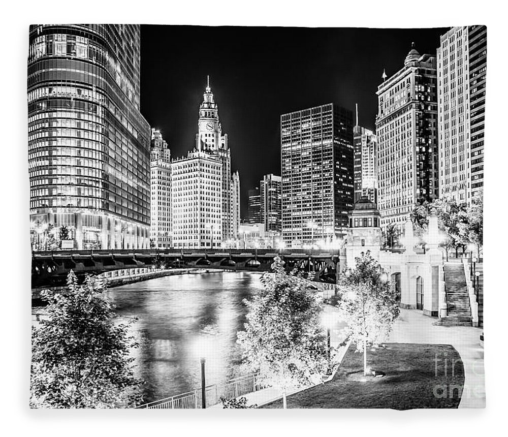 America Fleece Blanket featuring the photograph Chicago River Buildings at Night in Black and White by Paul Velgos