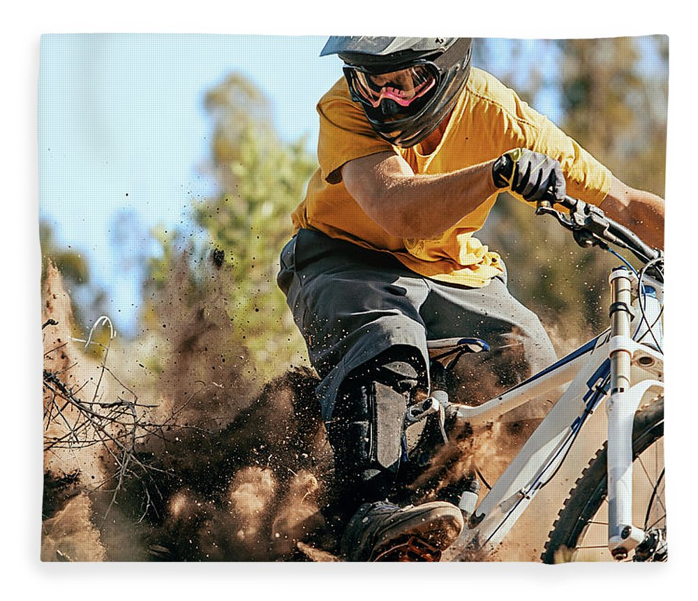 Headwear Fleece Blanket featuring the photograph Close Up Of A Mountain Biker Ripping by Daniel Milchev