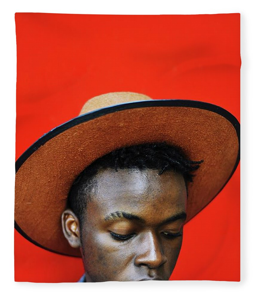 Young Men Fleece Blanket featuring the photograph Close-up Of Man Wearing Hat Against Red by Samson Wamalwa / Eyeem