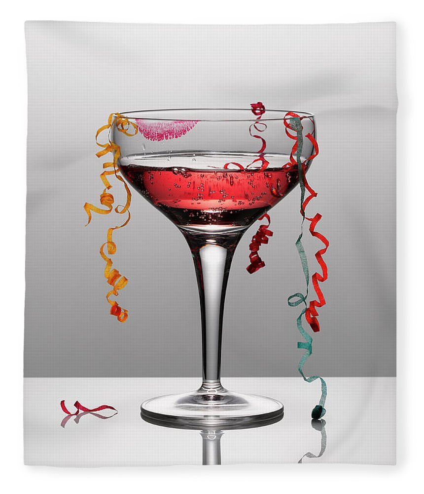 Streamer Fleece Blanket featuring the photograph Confetti Hanging From Glass Of Pink by Andy Roberts