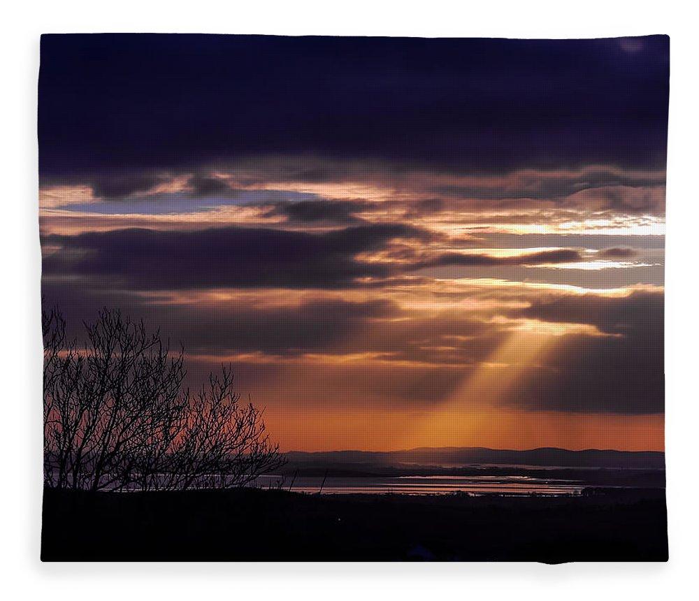 Celtic Skies Fleece Blanket featuring the photograph Cosmic Spotlight On Shannon Airport by James Truett