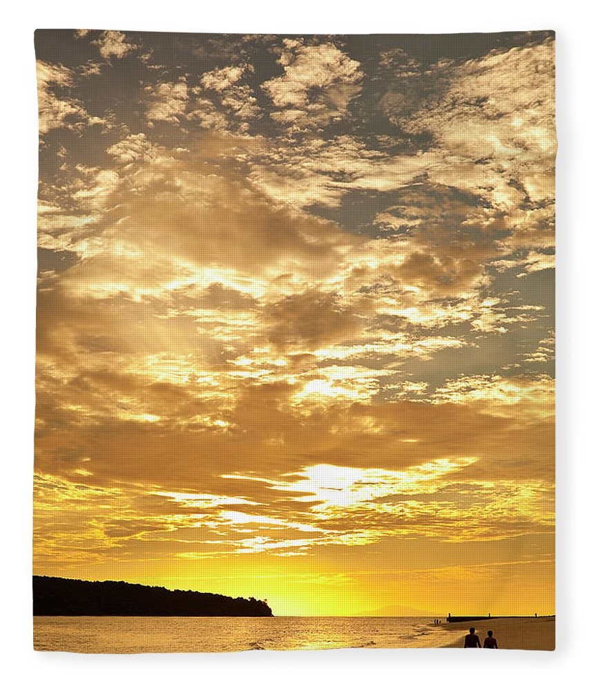 Scenics Fleece Blanket featuring the photograph Couple Walking On Beach At Sunset by Richard I'anson