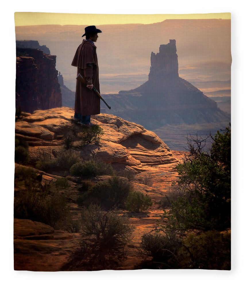 Cowboy Fleece Blanket featuring the photograph Cowboy On A Cliff by Jill Battaglia