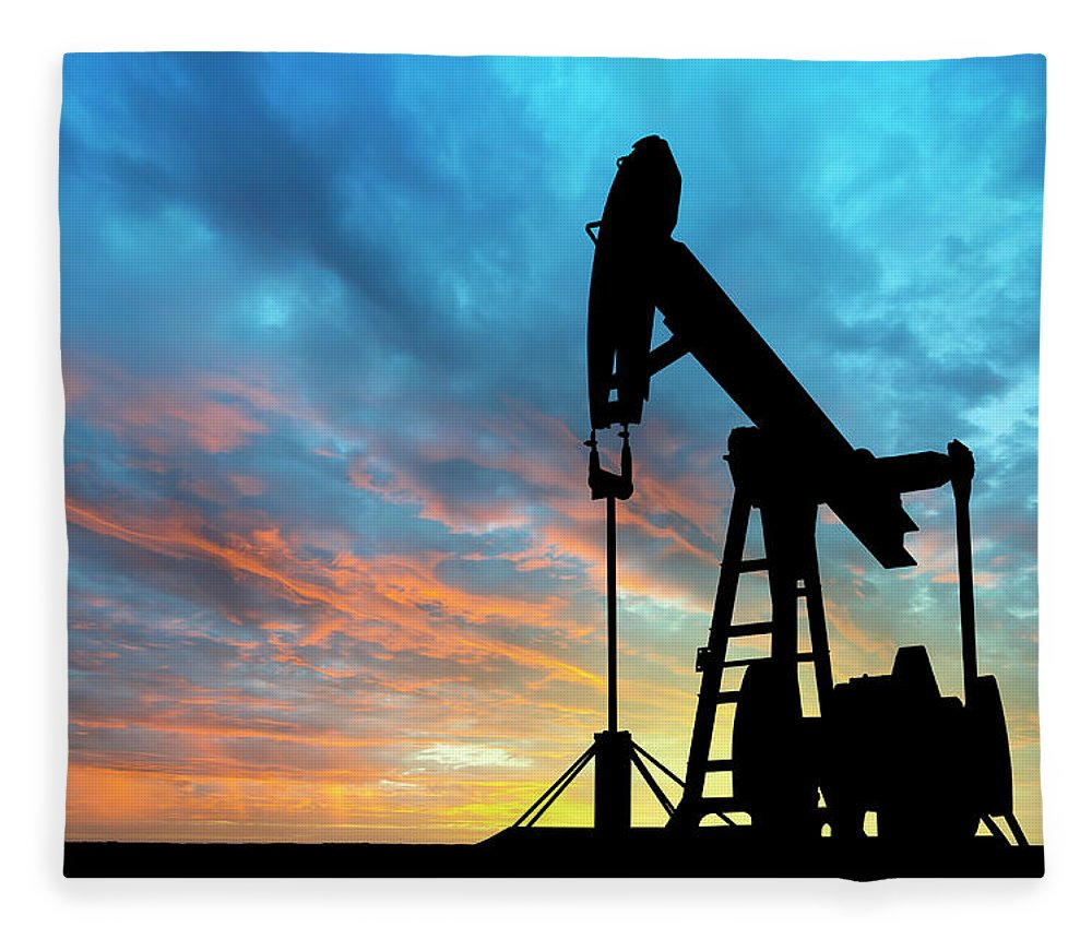Shadow Fleece Blanket featuring the photograph Dawn Over Petroleum Pump by Grafissimo