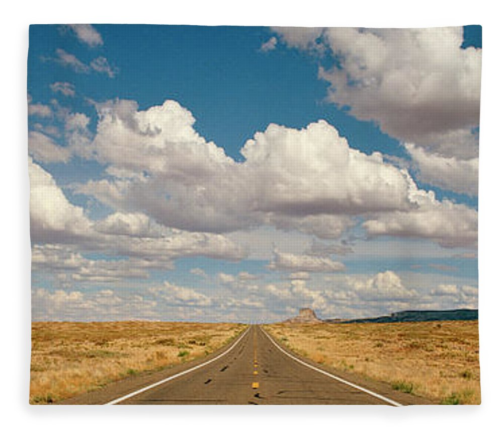 Scenics Fleece Blanket featuring the photograph Desert Road With Cloud Formations Above by Gary Yeowell