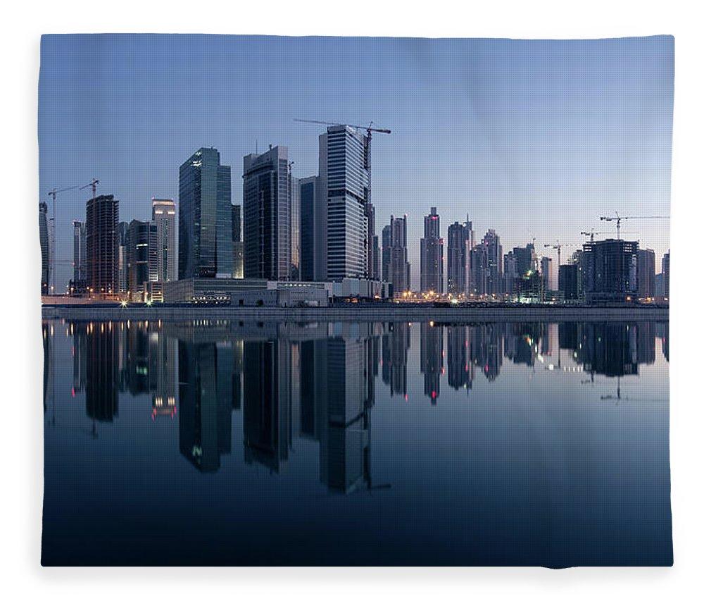 Tranquility Fleece Blanket featuring the photograph Dubai Business Bay Skyline With by Spreephoto.de