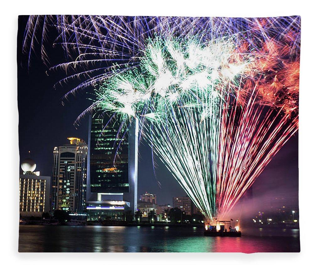 Firework Display Fleece Blanket featuring the photograph Dubai Creek Fireworks by Shahin Olakara Photography
