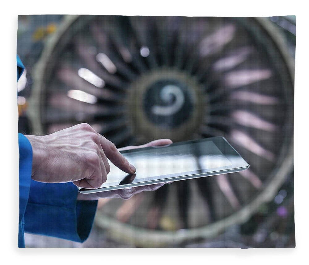 Focus Fleece Blanket featuring the photograph Engineer Using Digital Tablet In Front by Monty Rakusen