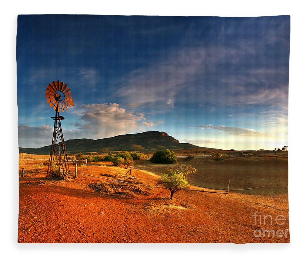 First Light Early Morning Windmill Dam Rawnsley Bluff Wilpena Pound Flinders Ranges South Australia Australian Landscape Landscapes Outback Red Earth Blue Sky Dry Arid Harsh Fleece Blanket featuring the photograph First Light on Wilpena Pound by Bill Robinson