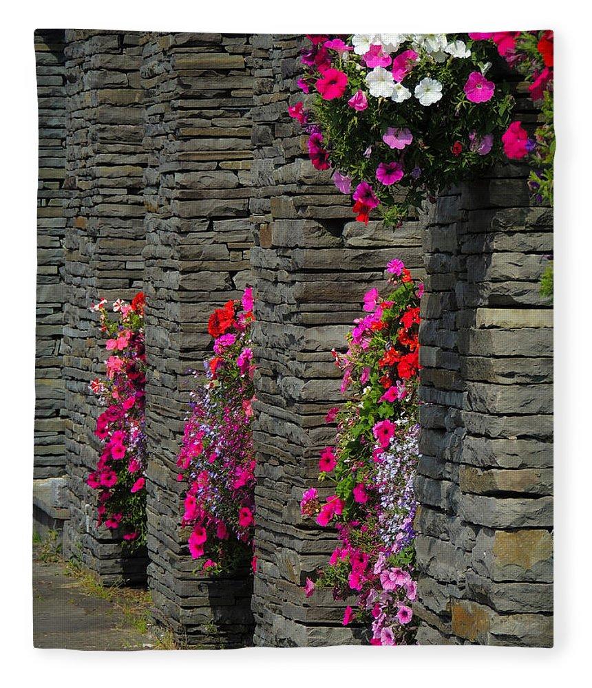 Flowers Fleece Blanket featuring the photograph Flowers At Liscannor Rock Shop by James Truett