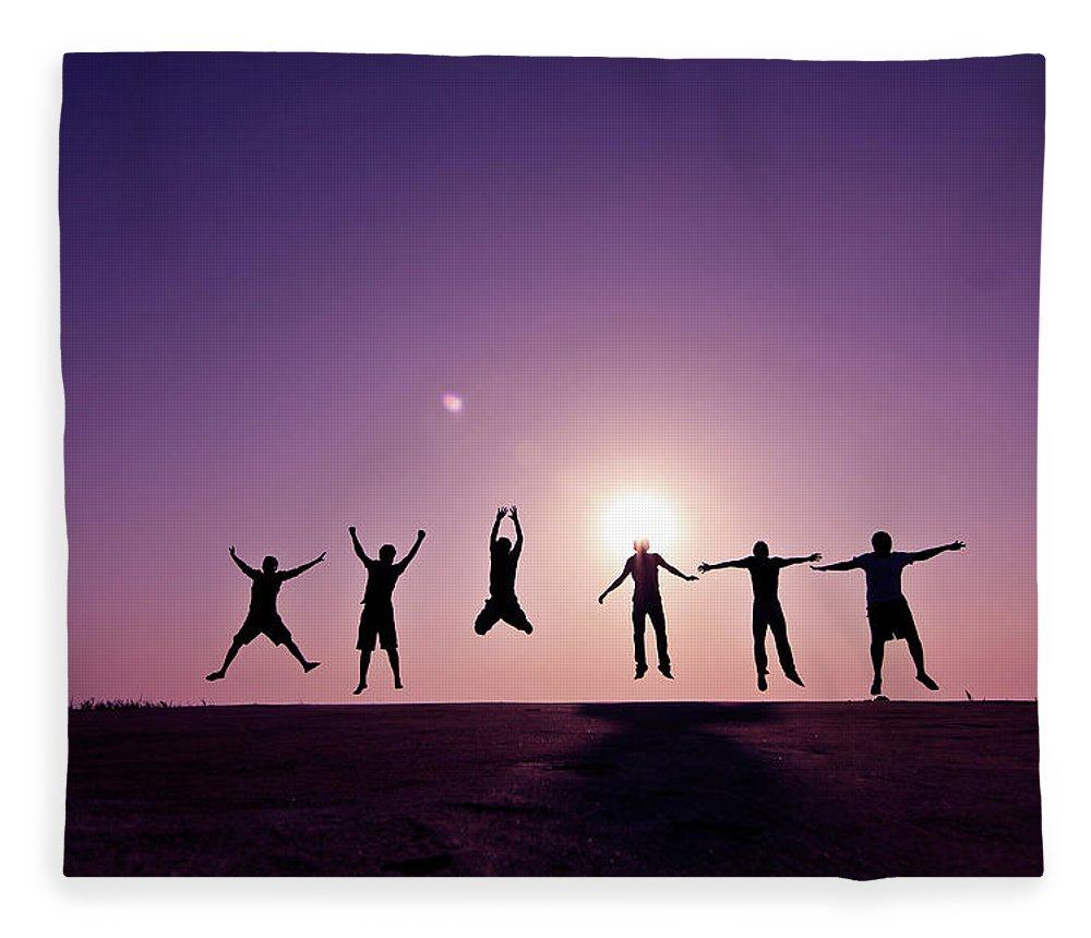 Human Arm Fleece Blanket featuring the photograph Friends Jumping Against Sunset by Kazi Sudipto Photography