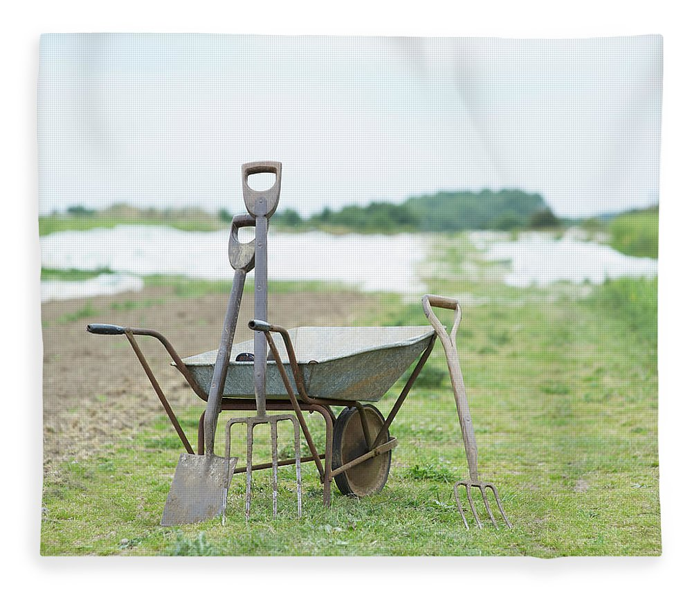 Grass Fleece Blanket featuring the photograph Gardening Tools And Wheel Barrow On by Dougal Waters