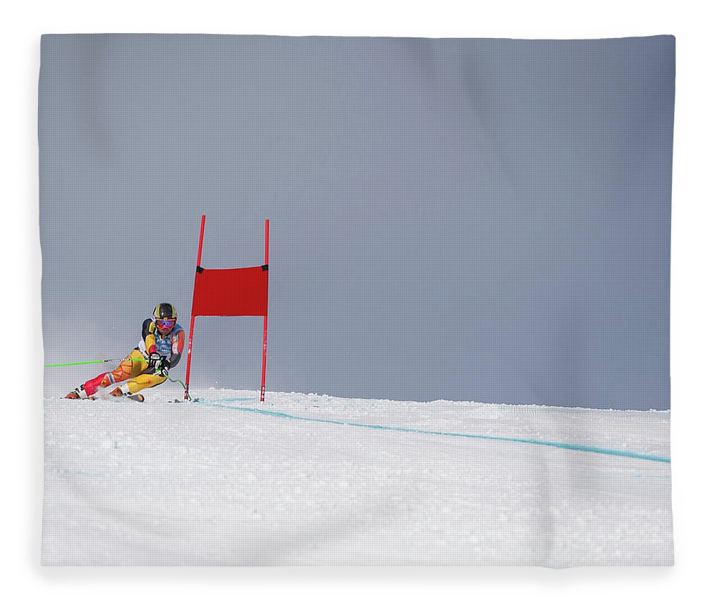 Skiing Fleece Blanket featuring the photograph Giant Slalom Skier Rounds Gate At High by Ascent Xmedia