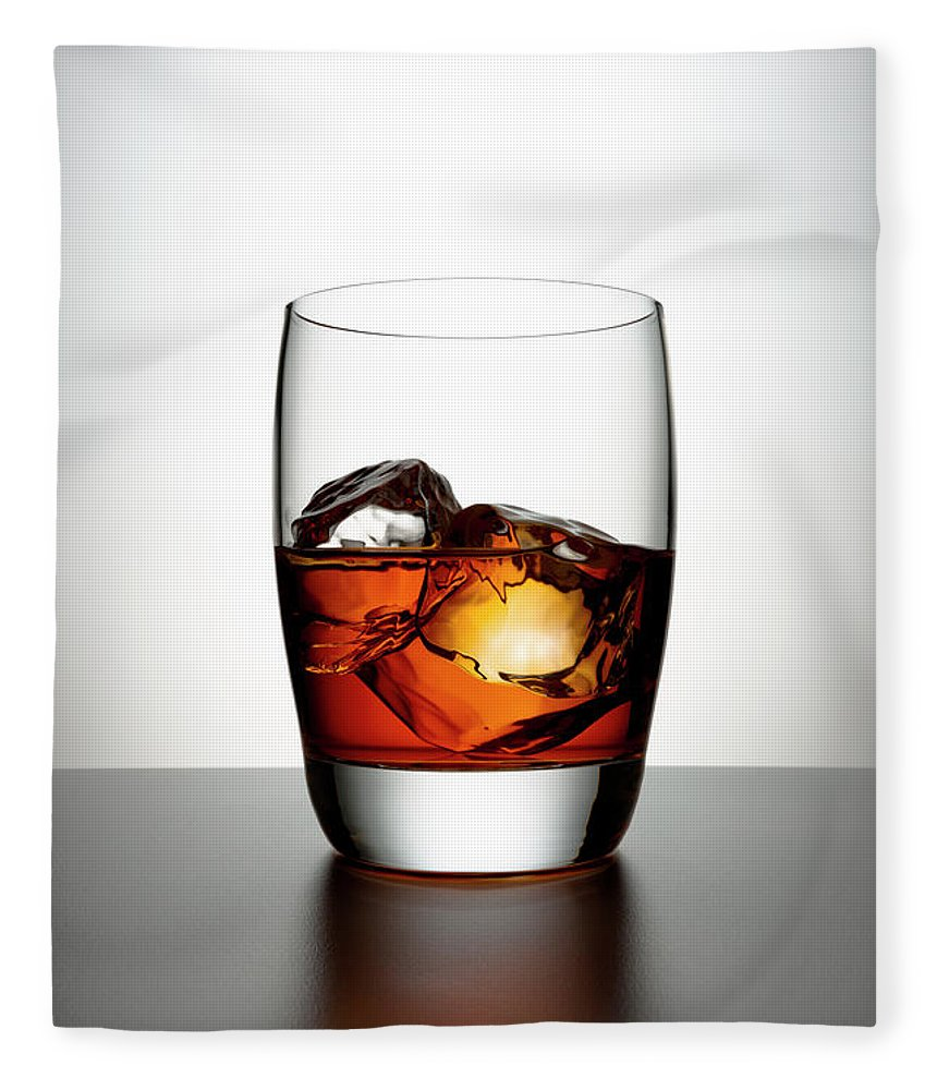 White Background Fleece Blanket featuring the photograph Glass With Brown Liquor And Ice Cubes by Chris Stein