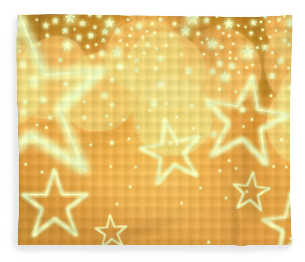 Christmas Lights Fleece Blanket featuring the photograph Glowing Background With Stars, Studio by Tetra Images