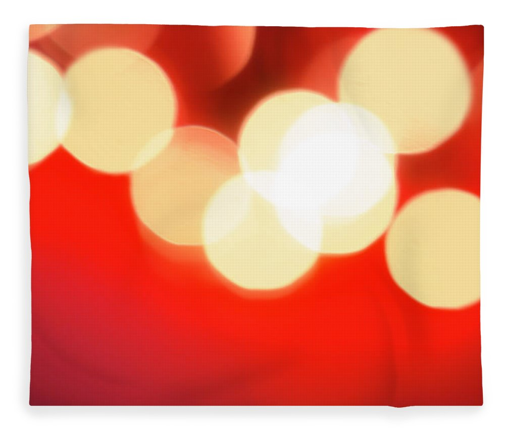Christmas Lights Fleece Blanket featuring the photograph Glowing Light On Red Background, Studio by Tetra Images