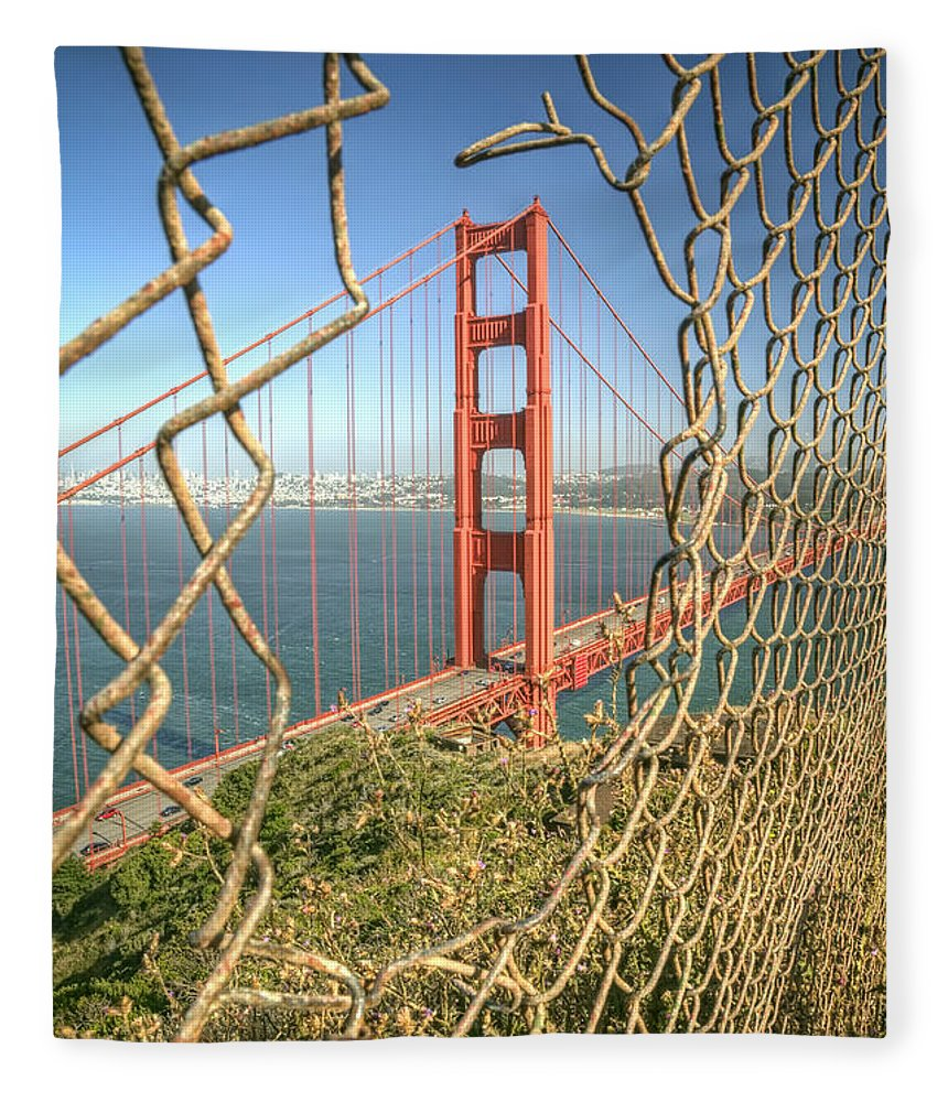 Golden Gate Fleece Blanket featuring the photograph Golden Gate through the fence by Scott Norris
