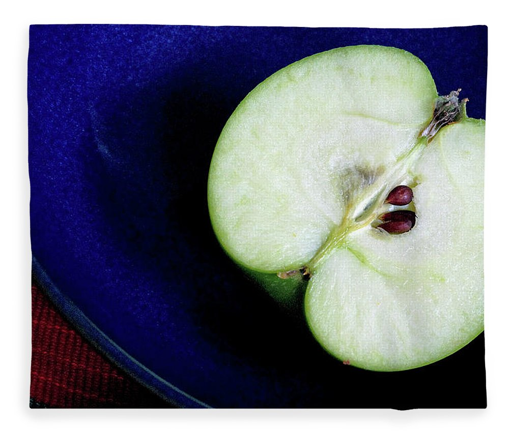 Healthy Eating Fleece Blanket featuring the photograph Half Of A Green Apple In A Blue Bowl by Rebecca E Marvil