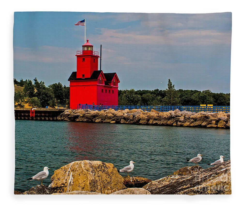 Attraction Fleece Blanket featuring the photograph Holland Harbor Light by Nick Zelinsky