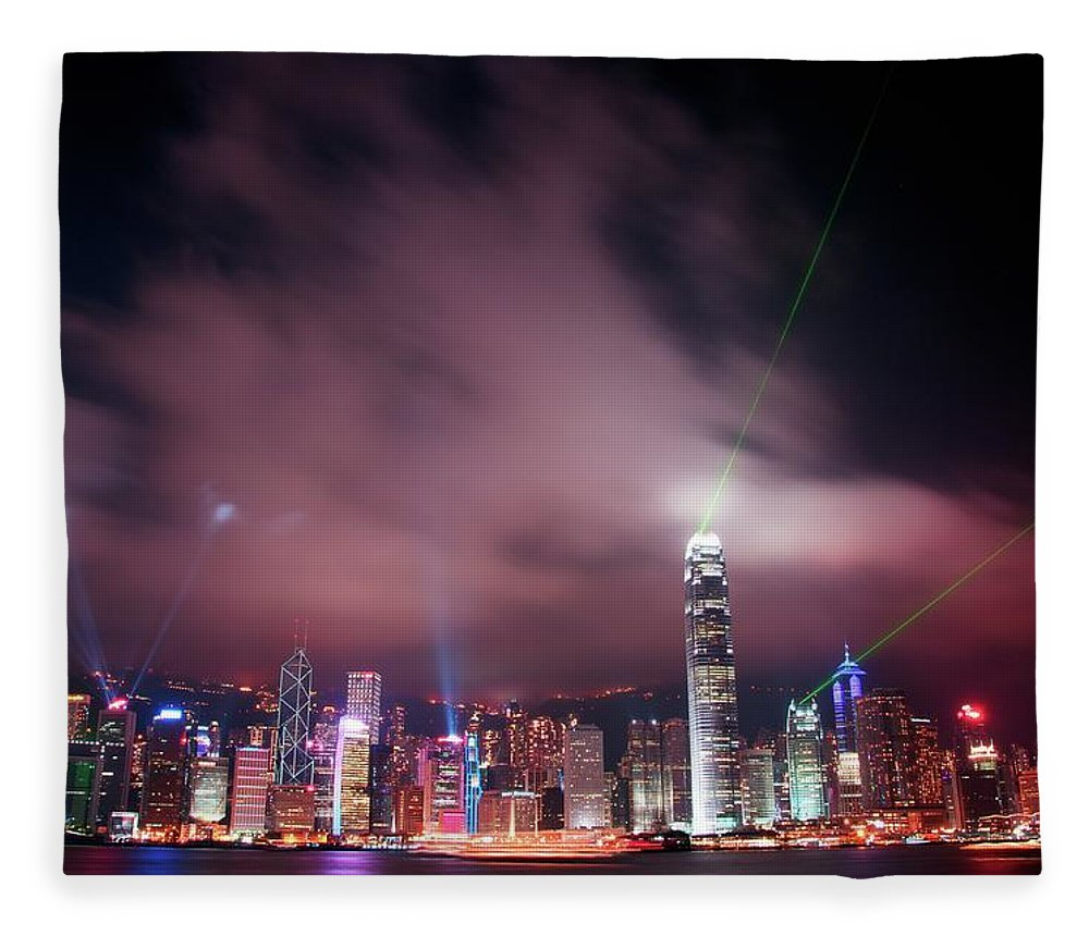 Tranquility Fleece Blanket featuring the photograph Hong Kong Laser Lights by Photo By Dan Goldberger