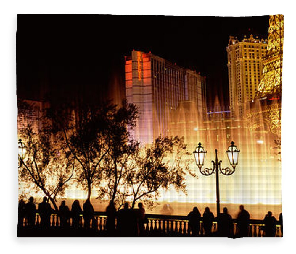 Photography Fleece Blanket featuring the photograph Hotels In A City Lit Up At Night, The by Panoramic Images