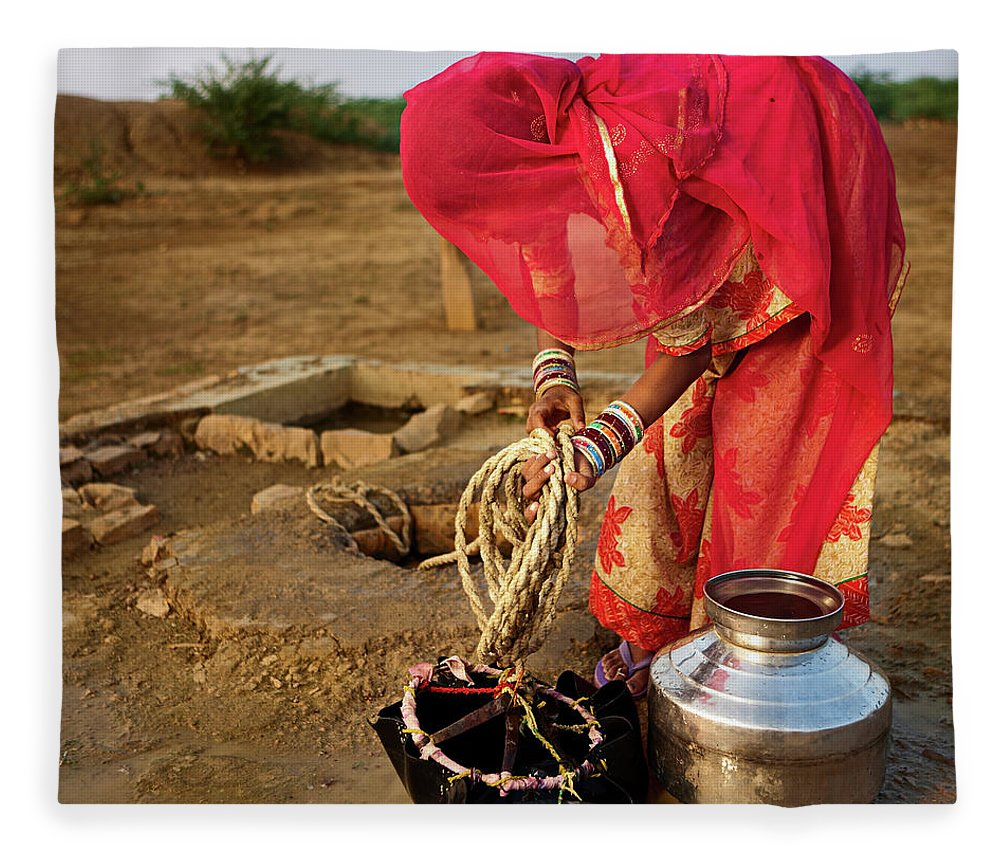 Working Fleece Blanket featuring the photograph Indian Woman Getting Water From The by Hadynyah