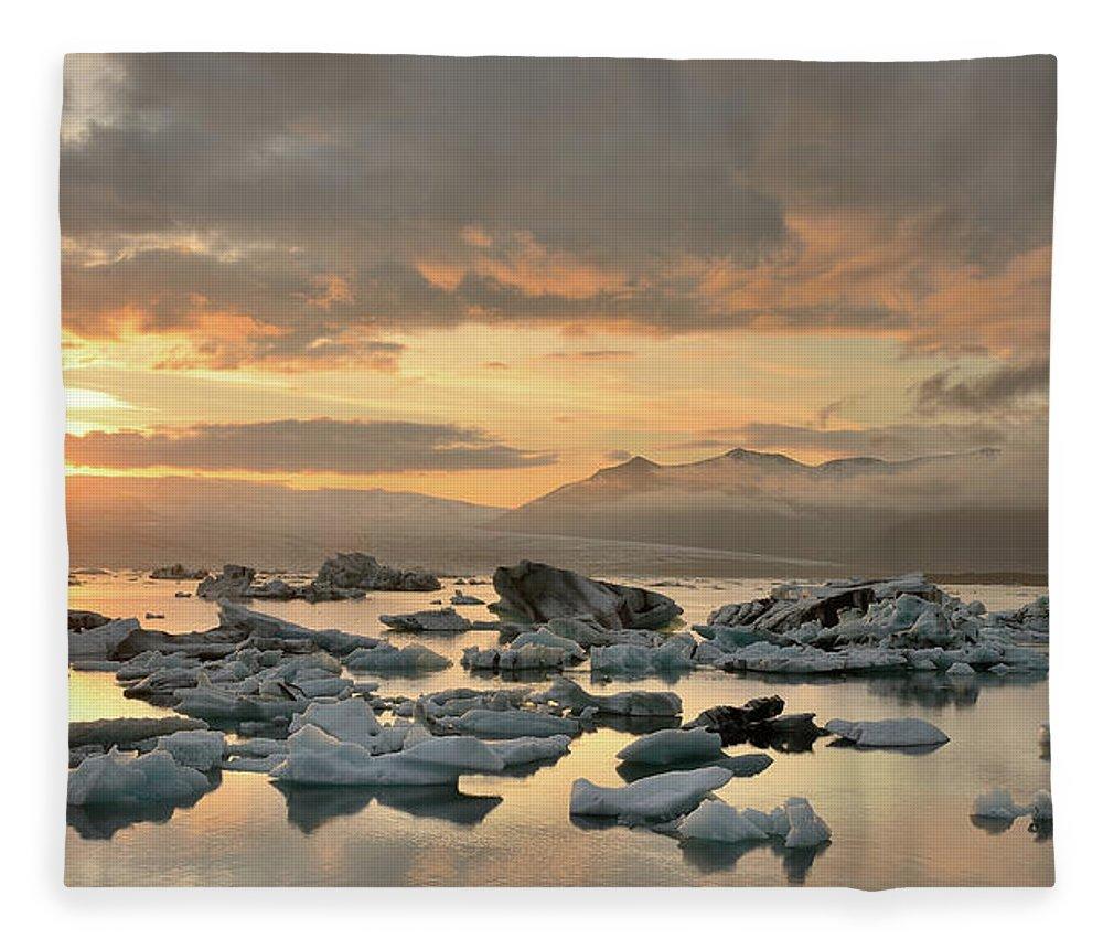 Scenics Fleece Blanket featuring the photograph Jökulsárlón by Andreas Jones