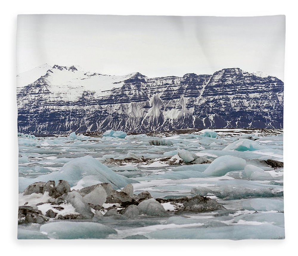 Tranquility Fleece Blanket featuring the photograph Jokulsarlon by Photo By Dave Moore