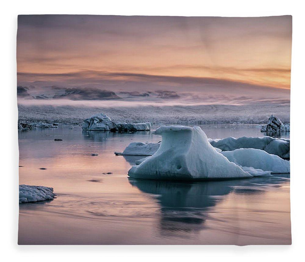 Scenics Fleece Blanket featuring the photograph Jokulsarlon Sunrise by Andreas Wonisch