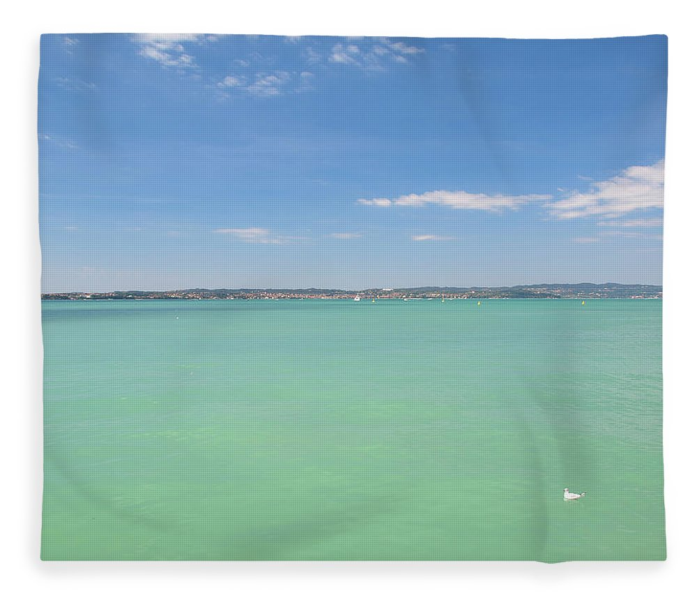 Scenics Fleece Blanket featuring the photograph Lago Di Garda by Goranstimac