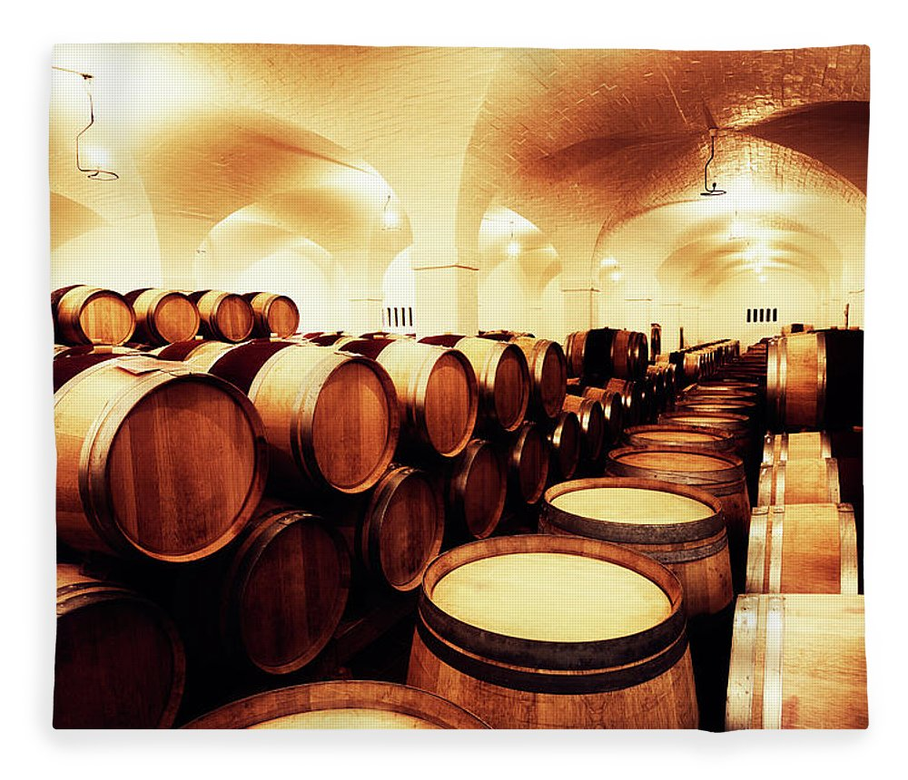 Alcohol Fleece Blanket featuring the photograph Large Winery Cellar Filled With Oak by Rapideye