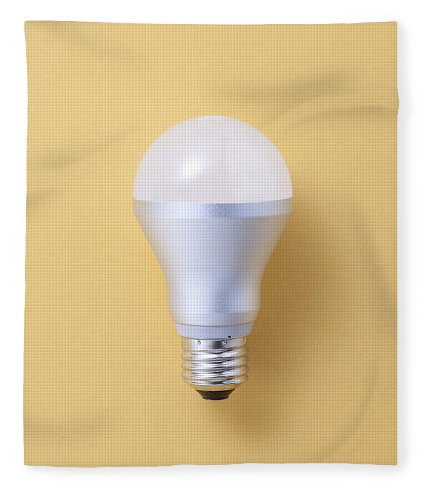 Environmental Conservation Fleece Blanket featuring the photograph Led Bulb by Imagenavi