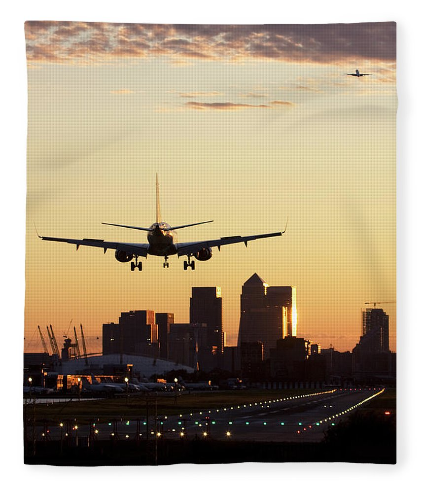 Taking Off Fleece Blanket featuring the photograph London City Airport by Greg Bajor