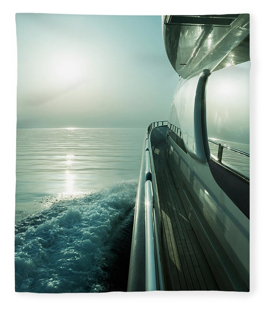 Desaturated Fleece Blanket featuring the photograph Luxury Motor Yacht Sailing At Sunset by Petreplesea