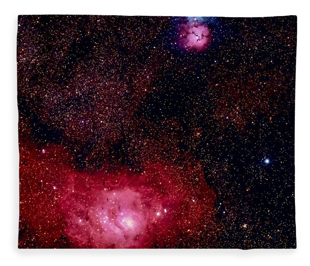 New Mexico Fleece Blanket featuring the photograph M8 The Lagoon Nebula And M20 The Trifid by A. V. Ley