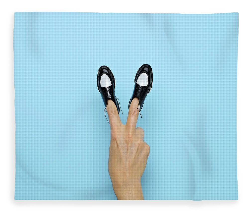 People Fleece Blanket featuring the photograph Making Peace Sign With Miniature Shoes by Juj Winn