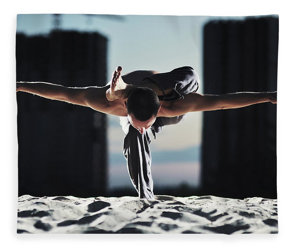 People Fleece Blanket featuring the photograph Man Holding Yoga Pose In The Sand by Myshkovsky