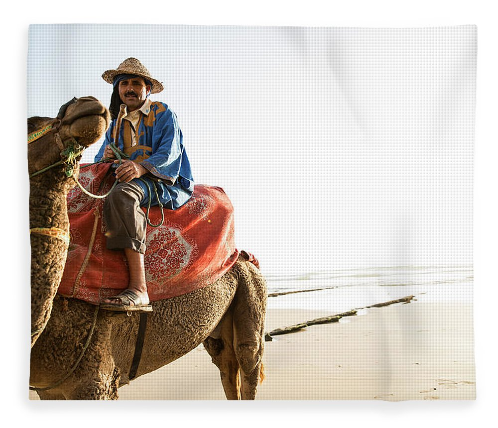 Agadir Fleece Blanket featuring the photograph Man On Camel On Beach, Taghazout by Tim E White