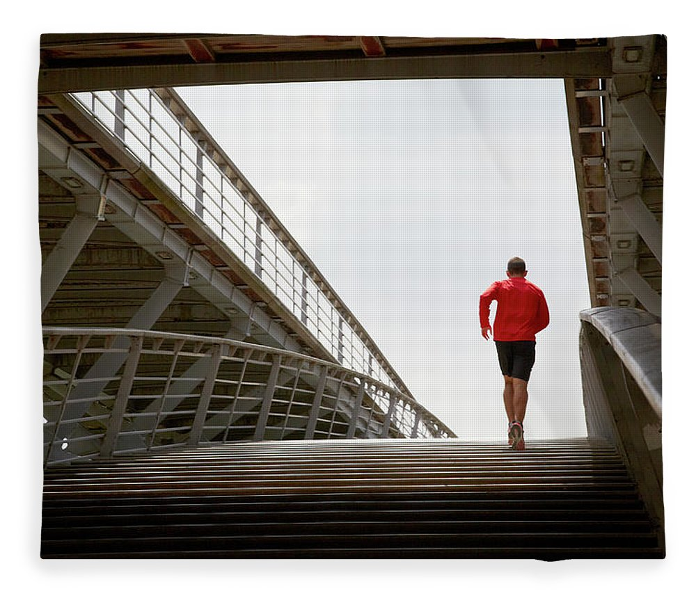 Steps Fleece Blanket featuring the photograph Man Running Up A Bridge by Chris Tobin