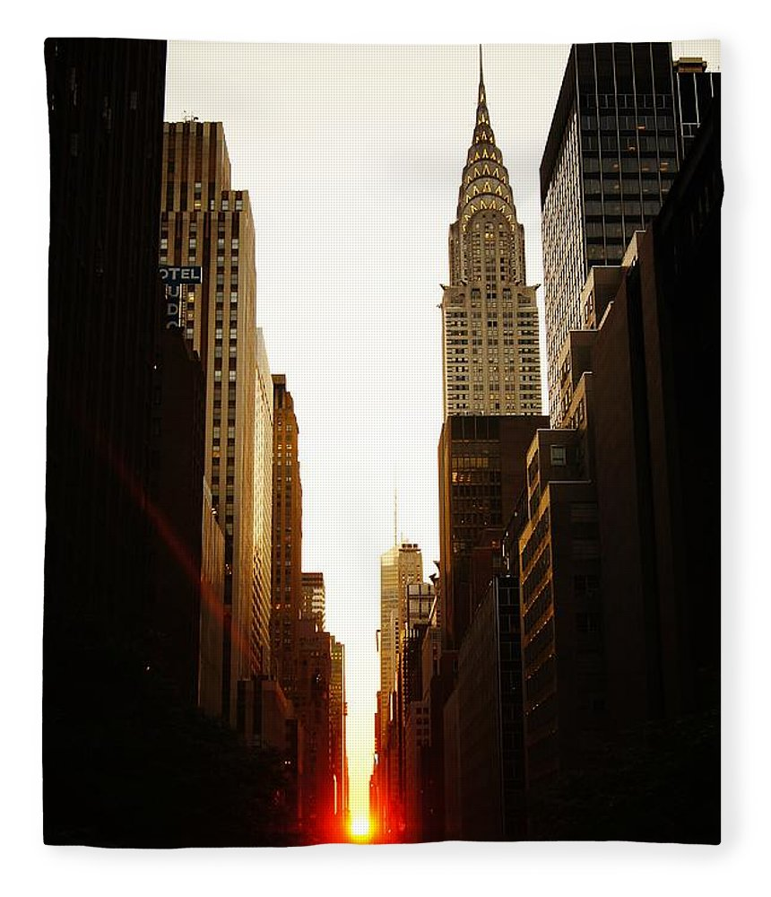 New York City Fleece Blanket featuring the photograph Manhattanhenge Sunset and the Chrysler Building by Vivienne Gucwa