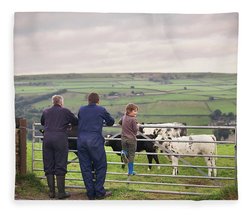 Mature Adult Fleece Blanket featuring the photograph Mature Farmer, Adult Son And Grandson by Monty Rakusen