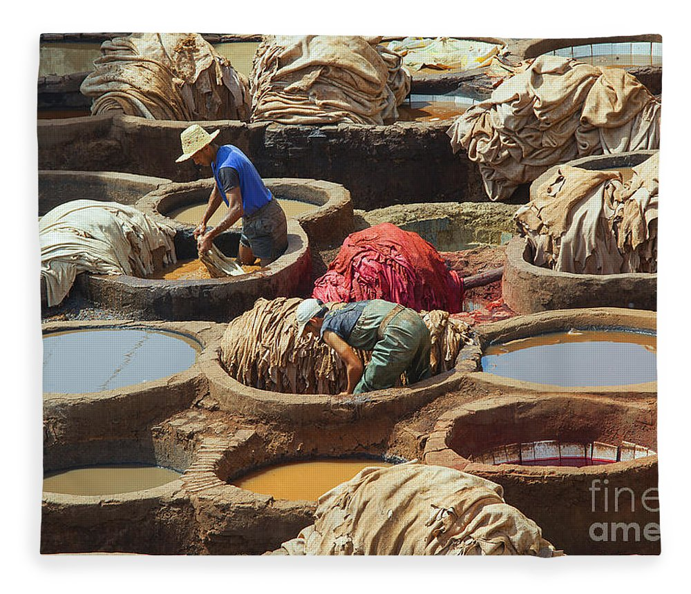 Africa Fleece Blanket featuring the photograph Men Dyeing Sheep Hides In Stone Vessels by Patricia Hofmeester