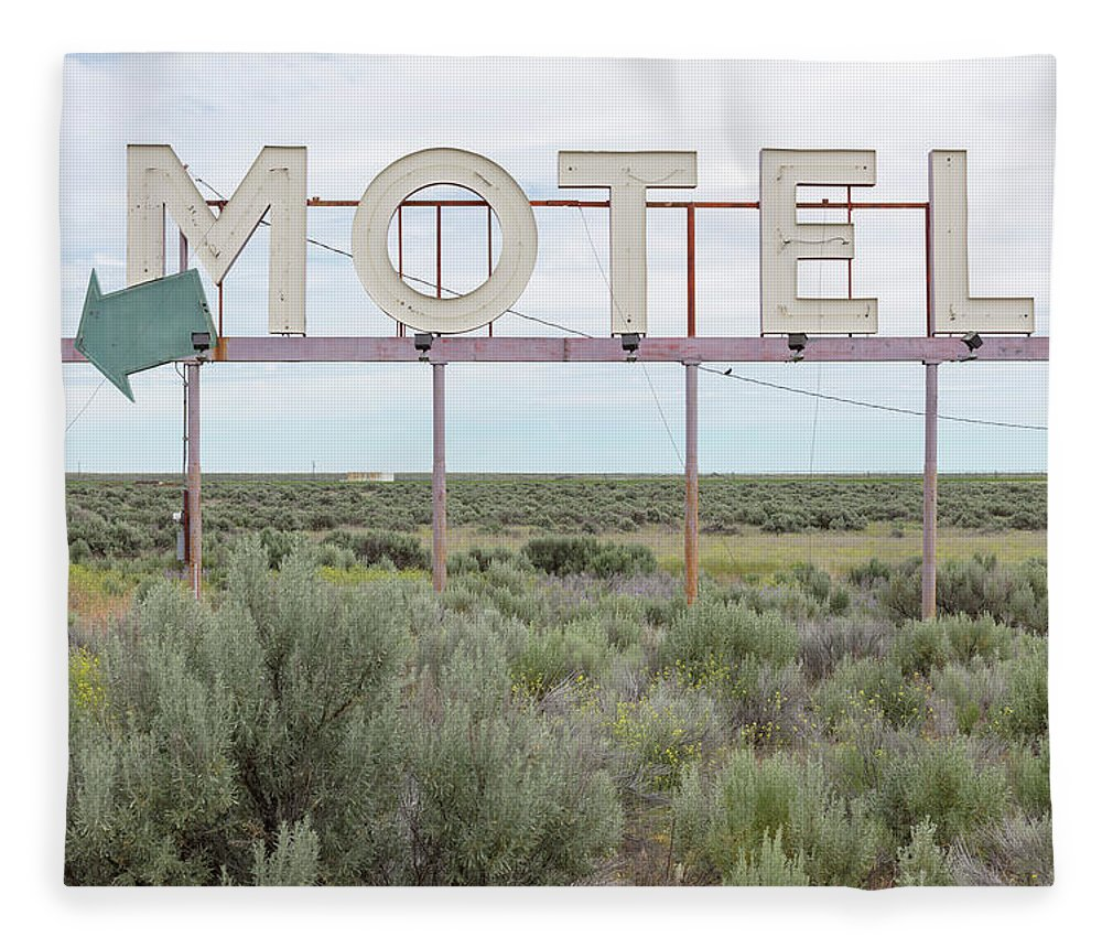 Grass Fleece Blanket featuring the photograph Motel Sign In Field Of Sage Brush, Out by Mint Images