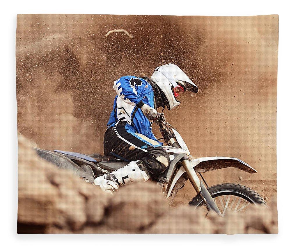 Crash Helmet Fleece Blanket featuring the photograph Motocross Biker Taking A Turn In The by Daniel Milchev