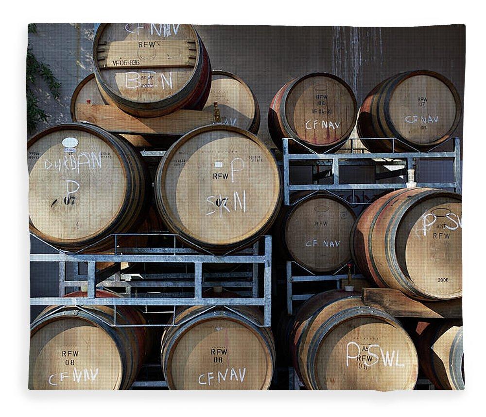 Stellenbosch Fleece Blanket featuring the photograph Multible Wooden French Winebarrels On by Klaus Vedfelt