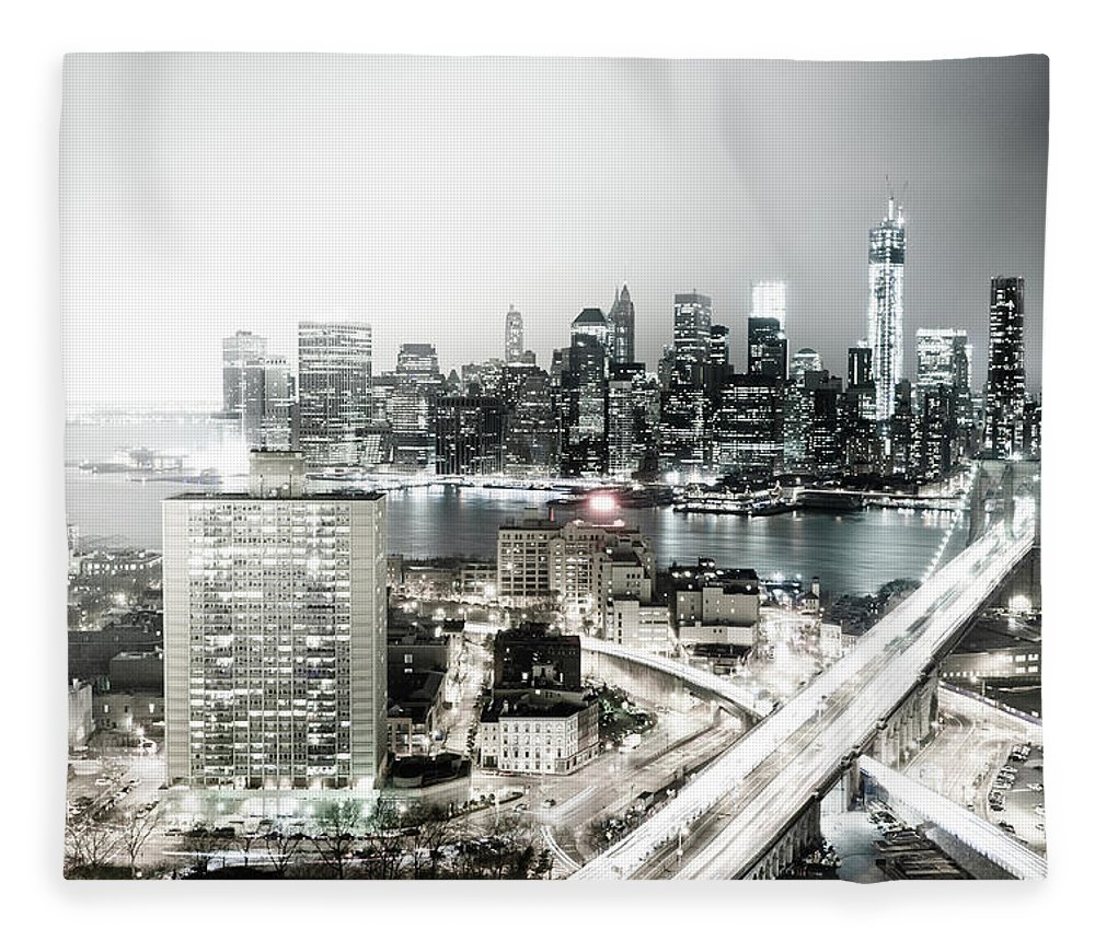 Lower Manhattan Fleece Blanket featuring the photograph New York City Skyline At Night by Mundusimages