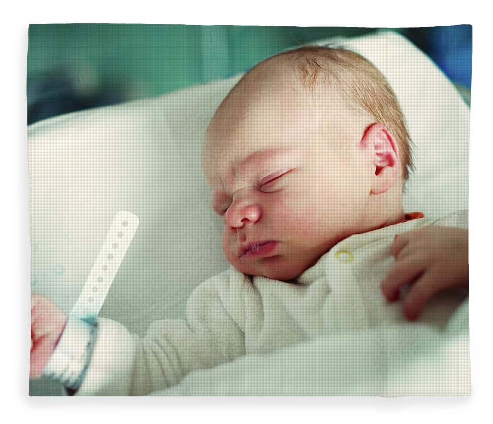 Tranquility Fleece Blanket featuring the photograph Newborn Boy. First Day by Aleksandr Morozov