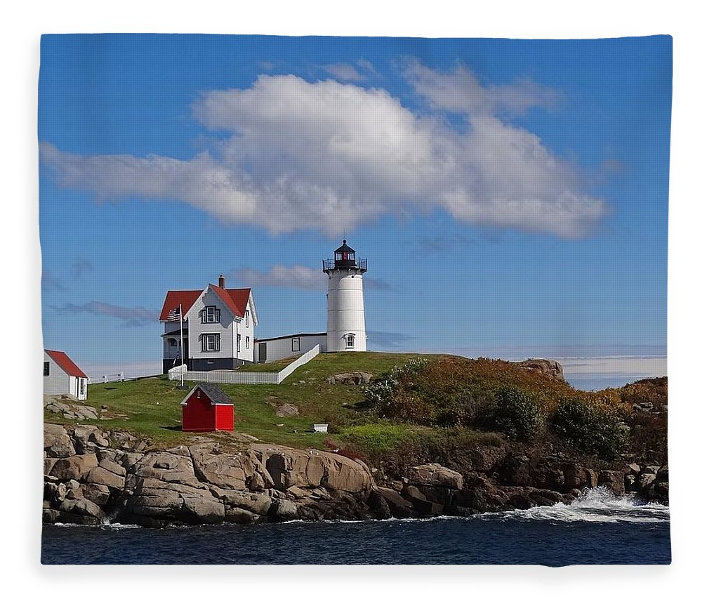 Tranquility Fleece Blanket featuring the photograph Nubble Lighthouse by Photo Jacques Trempe