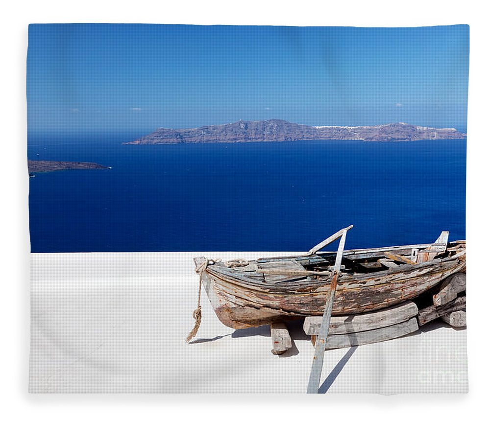 Santorini Fleece Blanket featuring the photograph Old Boat On The Roof Of The Building On Santorini Greece by Michal Bednarek