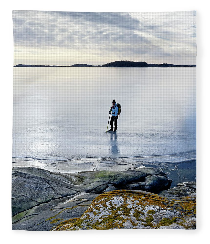 Archipelago Fleece Blanket featuring the photograph Person Skating At Frozen Sea by Johner Images
